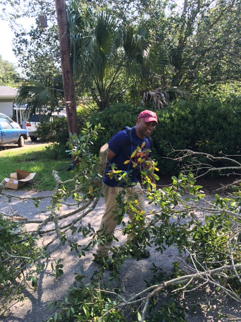 Secretary Lawson clearing debris around Tallahassee.