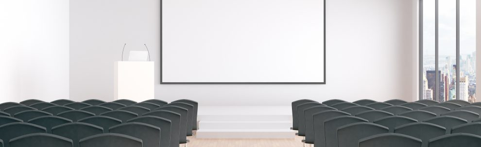 Blank whiteboard in conference hall interior with rows of seats, wooden floor, concrete walls and window with city view. Mock up, 3D Rendering